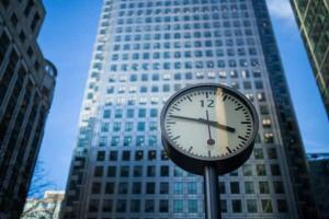 Image of a large clock in a city.