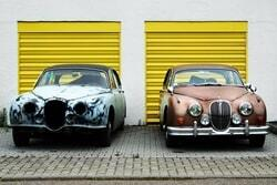 Image of two cars of the same model, one worn-out, and the other in pristine condition.
